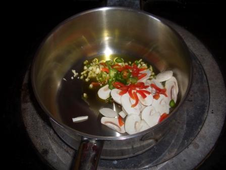 saute ingredients for spicy salmon soup