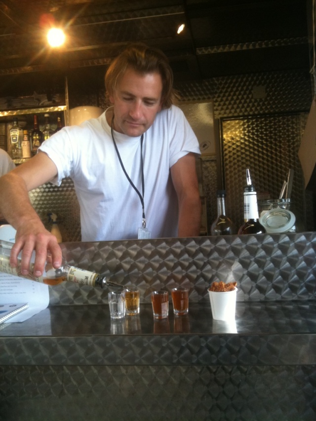 Jamie Berger serves a Pitt Cue Pickleback and Skin